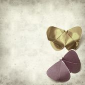 pic of kirigami  - textured old paper background with kirigami butterfly - JPG
