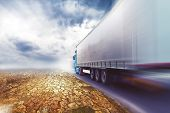 picture of semi-truck  - Speeding Transportation Truck driving on the road through the desert - JPG