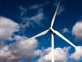 picture of wind-turbine  - white wind turbine and blue sky - JPG