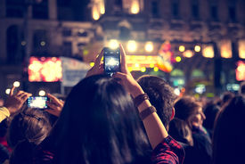 stock photo of candid  - Supporters recording at concert  - JPG