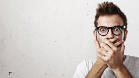 picture of shot glasses  - Portrait of a surprised young man wearing eyeglasses - JPG