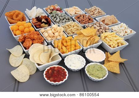 Savoury snack and dip food selection in porcelain dishes.