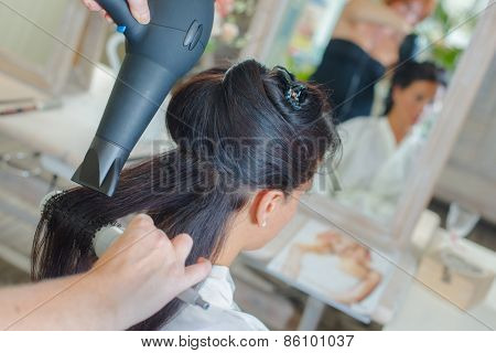 Brunette having her hair styled