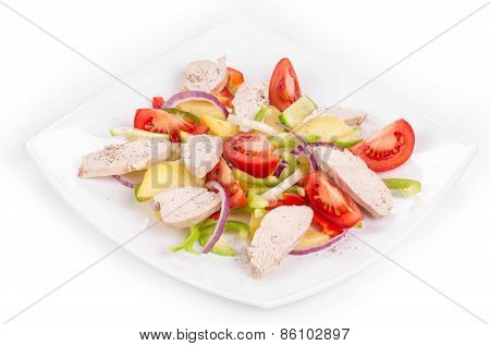 Warm meat salad with vegetables.