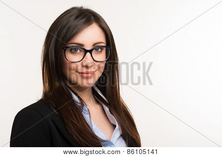 Portrait of a beautiful woman holding her eyeglasses