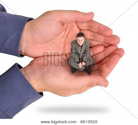 Business Man Trapped in Hand