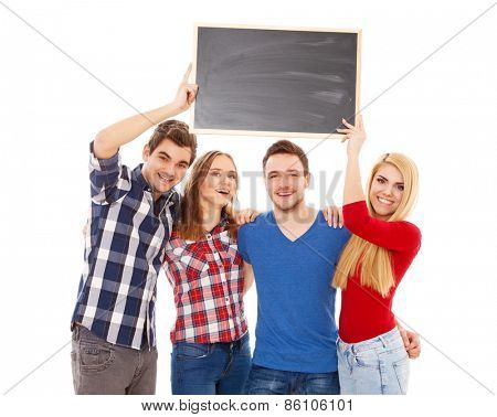Group of happy young people holding a blackboard
