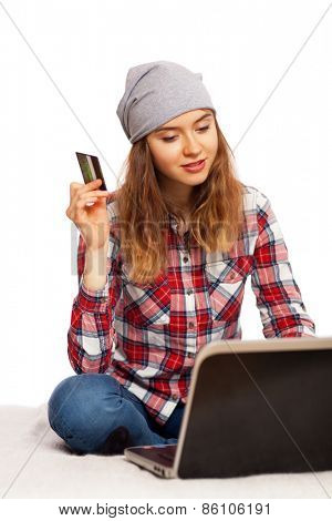 Young woman shopping online with a credit card