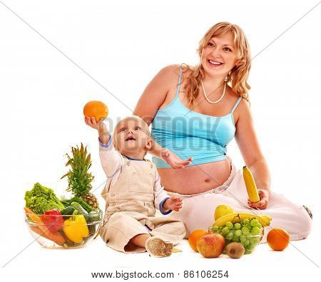 Pregnant woman woman and child preparing food. Isolated.