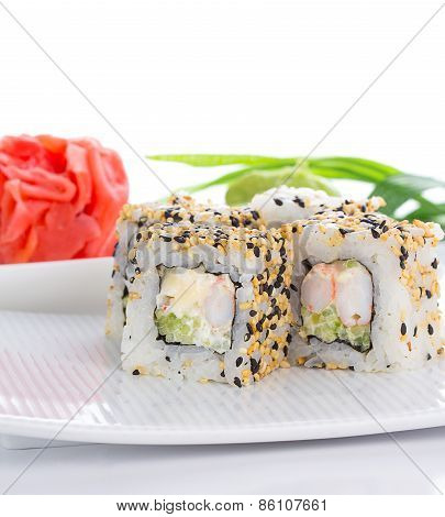 Sushi Roll On White Plate With Ginger And Wasabi