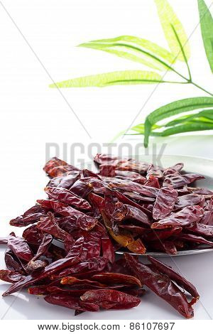 Red Chili Peppers Over White Background With Bamboo List