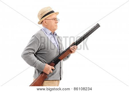 Senior gentleman with hat holding a rifle and standing in a row isolated on white background