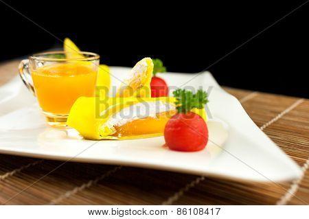Roll Pancake Mango With Mango Juice On Black Background
