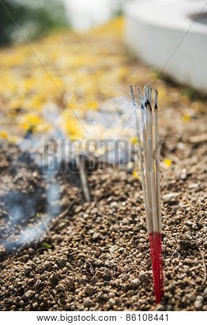 joss stick burning at chinese cemetery.