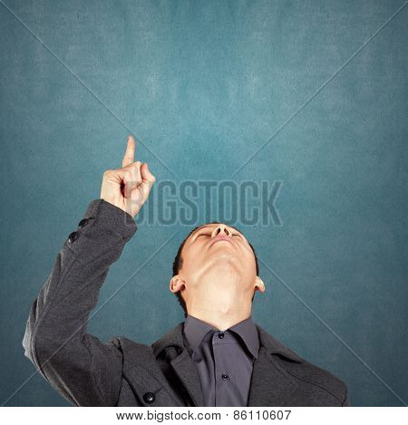 Idea concept with businessman looking upwards and showing something with finger