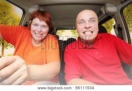 Hilarious couple taking a selfie in the car. Warm filtered look with added sun beam.