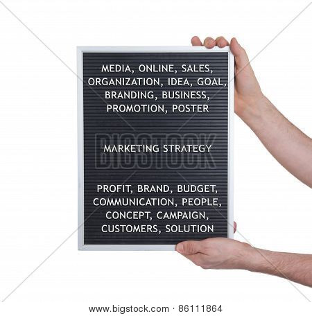 Marketing Strategy Concept In Plastic Letters On Very Old Menu Board