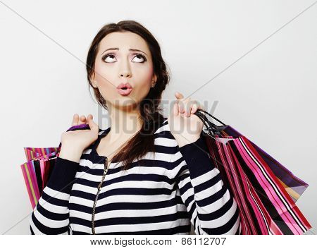 Portrait of young happy smiling woman with shopping bags.