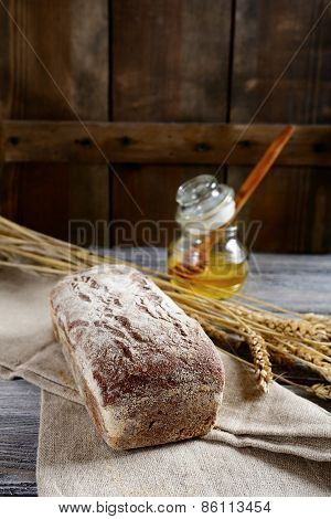 Delicious Bread With Spikelets Of Wheat On A Sacking