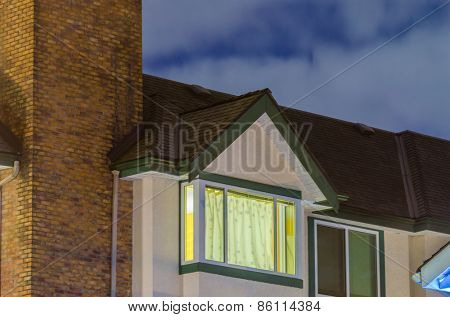 The roof of the house with nice window at night in Vancouver, Canada.