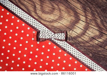 Vintage Background With Wood, Polka Dot Paper And Brown And White Polka Dot Ribbon With Bow
