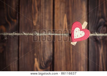 Red And White Paper Heart Hanging On Clothesline Against Wooden Background
