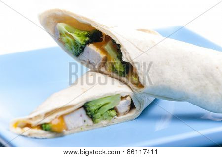 burrito with chicken meat and broccoli