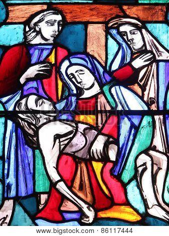 ELLWANGEN, GERMANY - MAY 07: Pieta, stained glass window in Basilica of St. Vitus in Ellwangen, Germany on May 07, 2014.