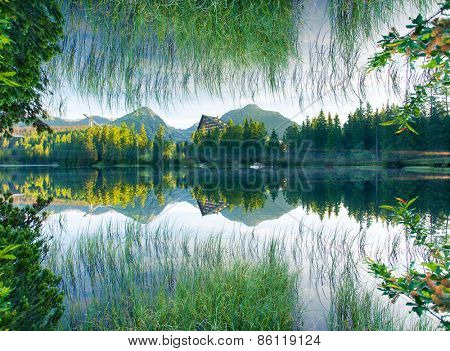 Fantastic mountain lake in National Park High Tatra. Dramatic scenery. Strbske pleso, Slovakia, Europe. Beauty world. Flip canvas vertical. Double exposure effect.