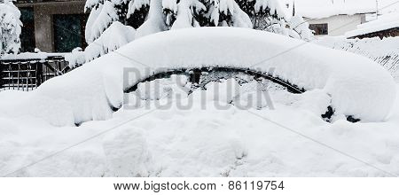 Car Covered With A Thick Snow Layer