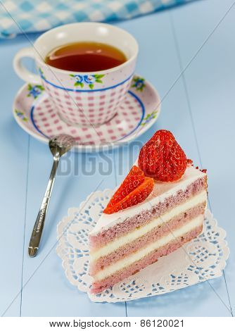A Piece Of Strawberry Cake With A Cup Of Tea