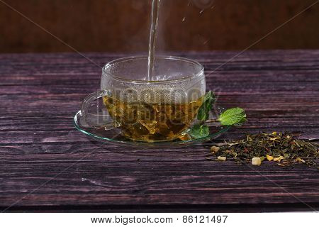 Tea Flows In A Transparent Cup