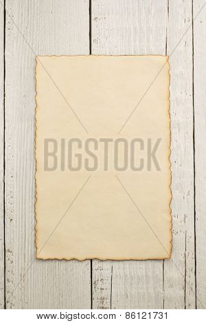 old parchment at wooden background texture
