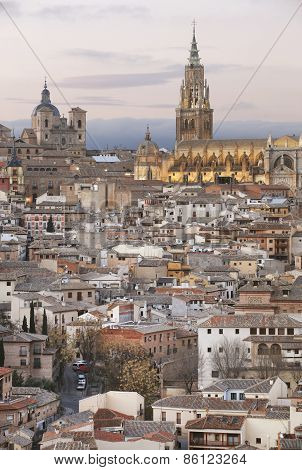 Toledo Skyline View At Sunset With Cathedral. Spain