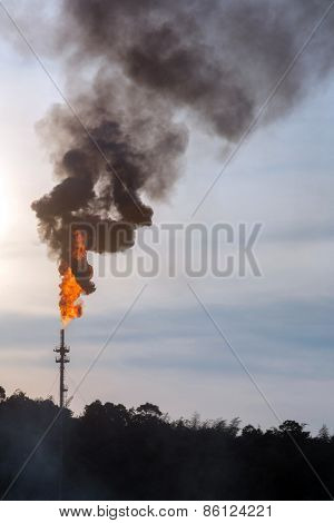 oil refinery Distillation tower with smoke stack pollution