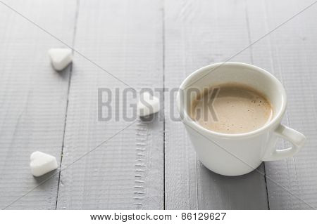 Coffee Cup With Milk And Sugar Cubes Scattered
