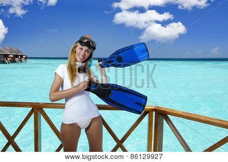 The young pretty woman in equipment for a snorkeling on the sundeck over the sea. Maldives