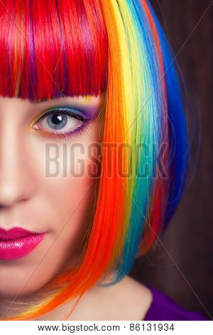 Beautiful Woman Wearing Colorful Wig Against Wooden Background