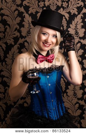 Beautiful Cabaret Woman Holding A Glass Of Red Wine Against Retro Wallpapers