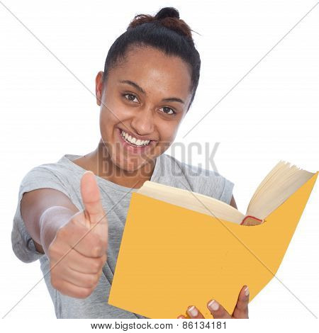 Happy Girl Holding A Book Showing Thumbs Up