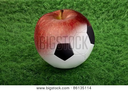 Soccer Ball On Green Grass To Apple