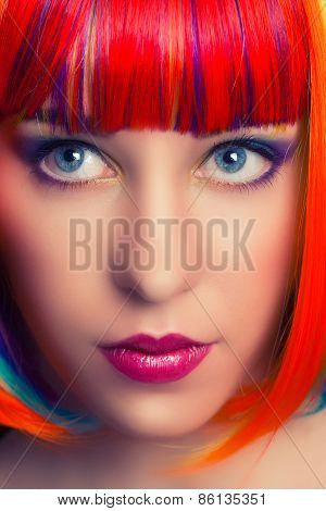 Portrait Of A Beautiful Woman Wearing Colorful Wig