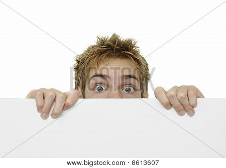 Young Adult Peeking Above White Sign