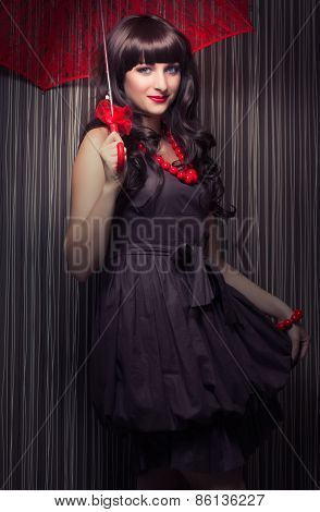 Beautiful Young Woman Posing With Red Lace Umbrella Against Retro Wallpapers