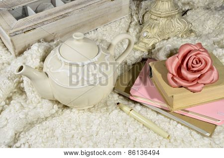 Teapot And Books