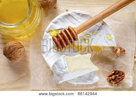 Delicious Piece Of Camembert Cheese With Honey