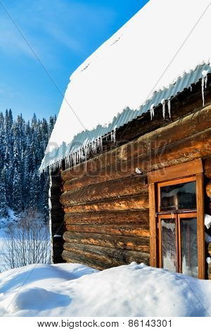 Beautiful Wooden House In A Winter Sunny Day