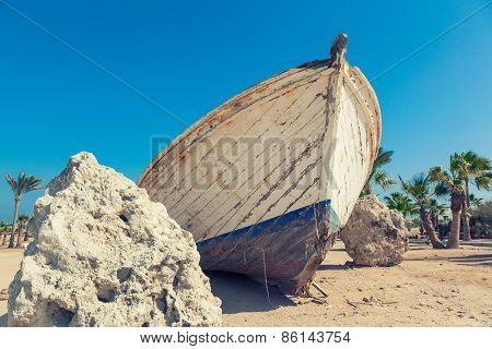 White Boat Wreck Lying On The Sand