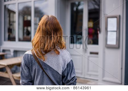 Young Woman Standing Outside Pub