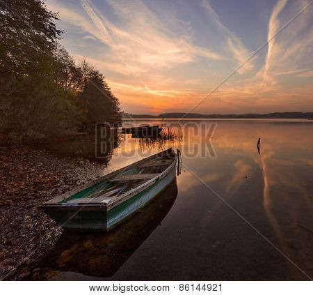 Sunset Lake With Fisherman Boat Landscape.